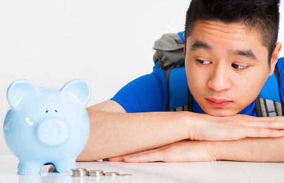 Teen with piggy bank and money