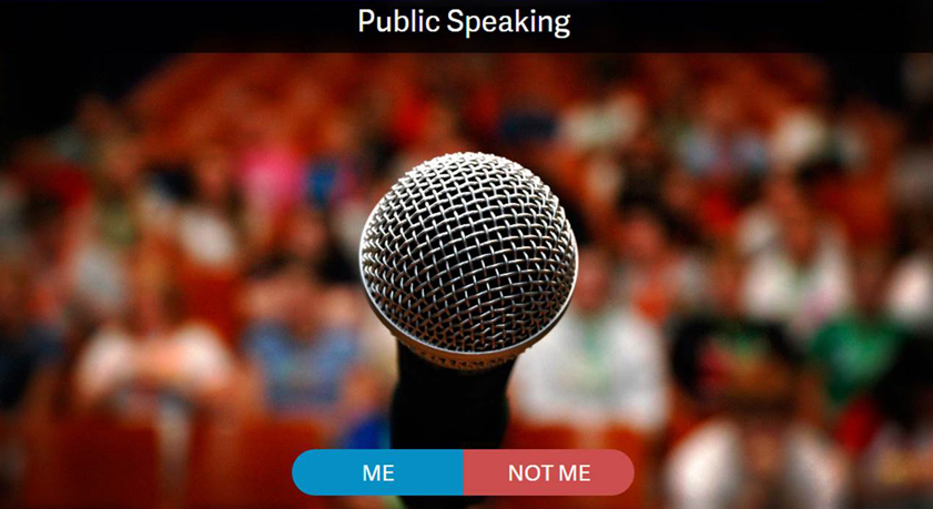 image of microphone with audience in background